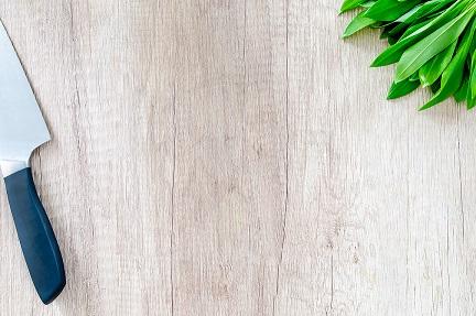 Fresh bear garlic on wooden table
